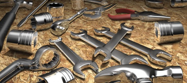 assorted wrenches lying on table